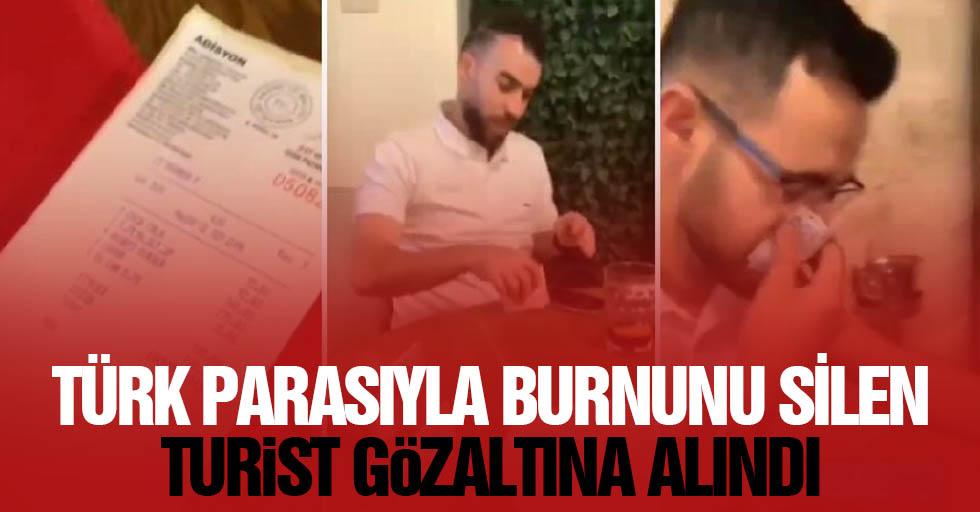 Türk parasıyla burnunu silen turist gözaltına alındı