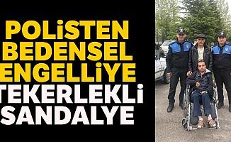 Polisten Bedensel Engelliye Tekerlekli Sandalye
