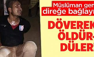 Müslüman genci direğe bağlayıp linç ettiler